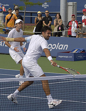 2009 ATP World Tour - Year-end No. 2 team of Daniel Nestor (left) and Nenad Zimonjić (right) recorded the most titles wins in 2009, with nine trophies.