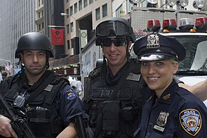 English: NYPD officers from the Emergency serv...