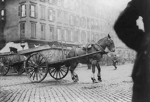 Strikebreaking driver and cart being stoned during sanitation worker strike. New York City, 1911. New York garbage cart being stoned.jpg