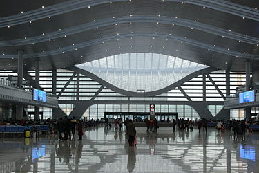 Ningbo New Railway Station was reopened in December 2013 after years of on-site restoration to accommodate high speed rails and increasing passengers. Ningbo New Railway Station Interior.JPG