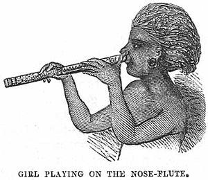 Nose flute - Fijian girl playing nose flute.