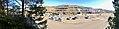 Oasen shopping mall (kjøpesenter, bydelssenter) in Folke Bernadottes vei, Fyllingsdalen, Bergen, Norway. Bergen Taxi, Skyss bus station, main entrance, etc. Distorted panorma (overexposed) 2018-03-17.jpg