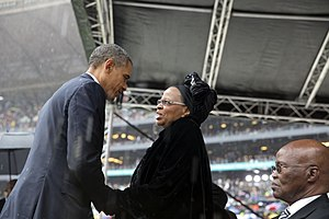 Graça Machel - US President Barack Obama greets Graça Machel at the memorial service for her late husband Nelson Mandela, Johannesburg, 2013