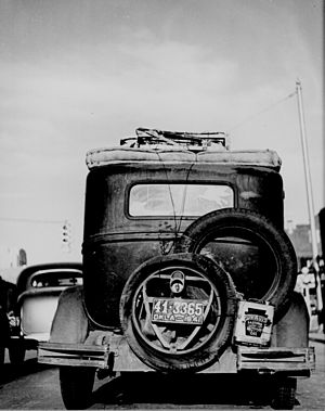 Okie - Rear view of an Okie's car, passing through Amarillo, Texas, heading west, 1941
