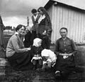Olga, Tatiana and Anastasia Nikolaevna with peasant people near Mogilev.jpg