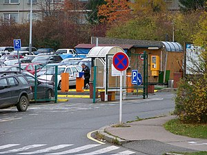 Park and ride - Park and ride car park in Prague-Opatov near the metro station, with a ticket machine offering integrated fare.