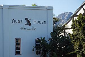 Oude Molen Distillery - Oude Molen emblem and motto in Stellenbosch
