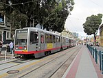 Outbound train at Duboce and Church, September 2017.JPG
