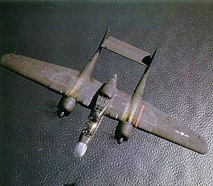 Northrop P-61 Black Widow - The P-61's upper turret is visible on the fuselage between the wings.