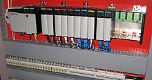 Modular PLC with EtherNet/IP module, digital and analog I/O, with some slots being empty.