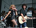 Paulina Rubio and Guitarist Jazz Fest 2012.jpg
