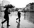 People with umbrellas in the United Kingdom.jpg