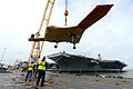 Personnel load a U.S. Navy X-47B Unmanned Combat Air System demonstrator aircraft onto the flight deck of the aircraft carrier USS George H.W. Bush (CVN 77) in Norfolk, Va., May 6, 2013 130506-N-TB177-270.jpg