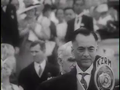 Philippine Commonwealth President Manuel L. Quezon speaking into a microphone at his inauguration.png