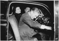 Photograph of Gerald R. Ford, Jr., and Betty Ford in the Front Seat of an Automobile Following Their Wedding Reception - NARA - 186986.tif