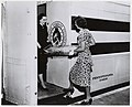 Photograph of National Archives Employees Peggy Mangum and Florence Nichol Loading the Log of the Frigate Constitution onto the Freedom Train (18463908653).jpg