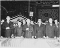 Photograph of President Truman, the Shah of Iran, Secretary of State Dean Acheson, and other dignitaries standing at... - NARA - 200144.tif