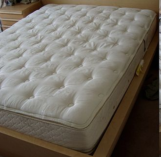 Bed size - A pillowtop queen-size mattress.