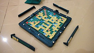 Scrabble - A near-ending game board, tiles and racks of the magnetic Pocket Scrabble (International, Mattel, Inc.)