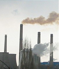 An image of industrial chimney smoke causing air pollution.