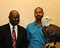 Posing for picture with Bald Eagle. (10595339735).jpg