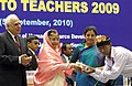 Pratibha Devisingh Patil presenting the National Award for Teacher-2009 to Shri Kapil Deo Prasad, Head Master, Bihar (Primary School Teachers category), on the occasion of the 'Teacher's Day', in New Delhi.jpg