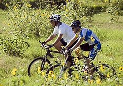 George W. Bush and Armstrong mountain biking at Prairie Chapel Ranch