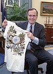 President George H. W. Bush Shows his T-Shirt Honoring Earth Day 1990.jpg