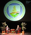 Purdue University President Mitch Daniels talks with Agriculture Secretary Tom Vilsack in 2014.jpg