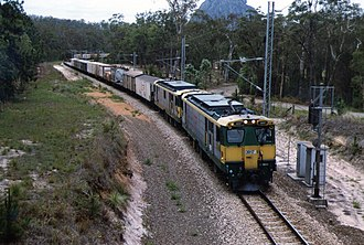North Coast railway line, Queensland - 3917 and another haul a northbound goods train on the NCL with Mount Tibrogargan in the background