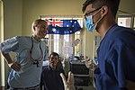 RAAF dentist speaking with an interpreter in Vietnam during September 2018.jpg