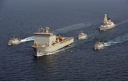 "The RN presence in the Persian Gulf typically consists of a Type 45 destroyer and a squadron of minehunters supported by an RFA Bay-class ""mothership"" RN Flotilla 45154692.jpg"