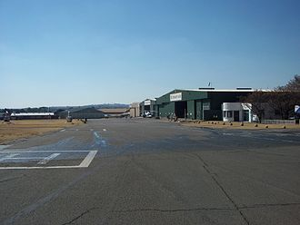 Rand Airport -  View of the northwest apron with the Henley Air hangars on the right.