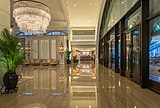 Reception hall with reflecting floor and chandelier at The Fullerton Bay Hotel Singapore.jpg