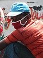Ricksha Driver with Mask against Pollution - Chittagong - Bangladesh (13103305715).jpg