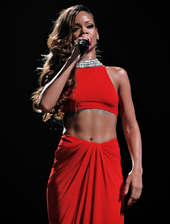 A picture of a woman dressed in red singing