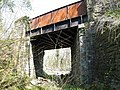 Road bridge over Taff Railway trackbed Creigiau - geograph.org.uk - 1885135.jpg