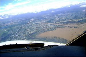 2010–11 Queensland floods - Rockhampton seen from the air on 31 December; the Fitzroy River can be seen to have burst its banks