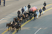 Ronald Reagan's casket, on a horse-drawn caisson, being pulled down Constitution Avenue to the Capitol Building