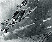 SBD-3 Dauntless bombers of VS-8 over the burning Japanese cruiser Mikuma on 6 June 1942