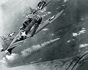 SBD-3 Dauntless bombers of VS-8 over the burning Japanese cruiser Mikuma on 6 June 1942.jpg