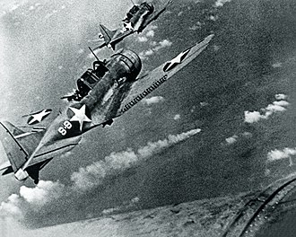 Battle of Midway - Image: SBD 3 Dauntless bombers of VS 8 over the burning Japanese cruiser Mikuma on 6 June 1942