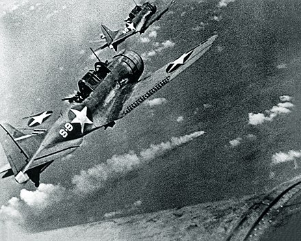 American Douglas SBD Dauntless dive-bomber aircraft attacking the Japanese cruiser Mikuma during the Battle of Midway in June 1942 SBDs and Mikuma.jpg