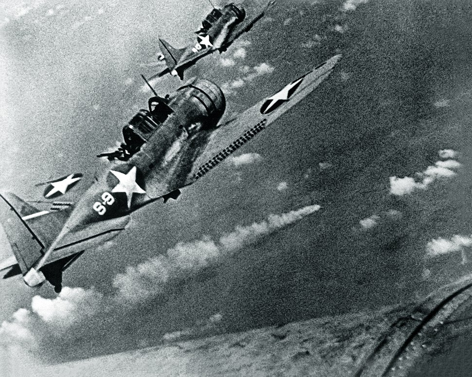 SBD-3 Dauntless bombers of VS-8 over the burning Japanese cruiser Mikuma on 6 June 1942