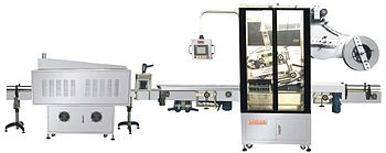 English: machine for sleeve labeling