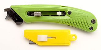 Utility knife - A modern safety cutter at top, with blunted tip blade and cutting guide/tape hook. At bottom, an older style simple plastic box cutter using standard straight edged blades.