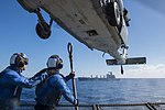 Sailor prepares to attach cargo pallets to an MH-60S Sea Hawk helicopter. (36424725045).jpg