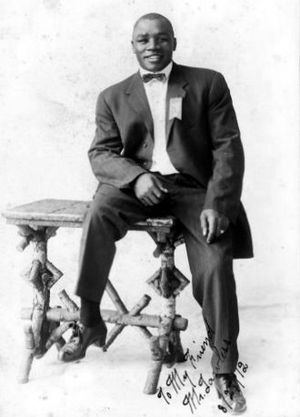 "Sam Langford - Portrait of Sam Langford, ""The Boston Tar Baby"", African Canadian boxer and Australian heavyweight champion, photograph 1912"