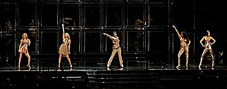 """Spice (album) - The group during the Return of the Spice Girls tour performing """"Say You'll Be There"""", dressed in Roberto Cavalli's bronze and copper coloured outfits."""