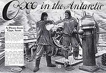 "Advertisement showing two men in heavy clothing on the deck of a ship, with icy mountains in the background. The men are pouring drinks from a jug, The slogan reads ""Oxo in the Antarctic"""